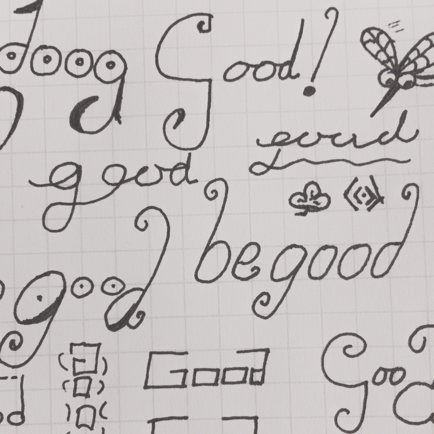 Photo of a gridded page with Good doodled in ink.